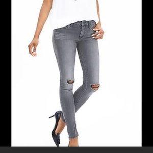 Distressed dark grey jeans